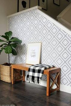 When an awkward wall stands in the way, highlight the space with a lovely wallpaper print rather than disguising it behind furniture or artwork.  Or, if there's enough real estate to play with, use a combination of all three.  This extra large diamond pattern gives the wall a pretty edge and a spacious feel.