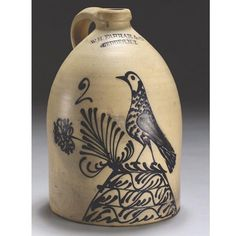 A FINE AND RARE TWO-GALLON SALT-GLAZED AND BLUE SLIP-DECORATED 'BIRD ON MOUND WITH FLORALS' STONEWARE JUG, WILLIAM H.MEASUREMENTS height 13 3/4 in. 34.9cmDESCRIPTION stamped W.H. Farrar & Co. / Geddes, N.Y., and with the number 2 in blue slip.