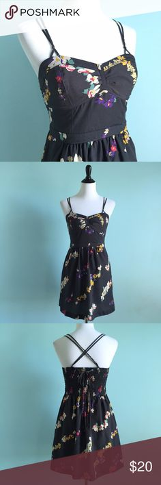 AEO Summer Dress Beautiful summery dress by American eagle outfitters. Dark grey dress with floral print with colors of purple, yellow, and white. You tie the straps on the back, creating a pretty design. American Eagle Outfitters Dresses