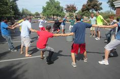 To keep things safe, divide boys and girls – creating two different games.  Individuals will link arms, forming a large circle. Pla...