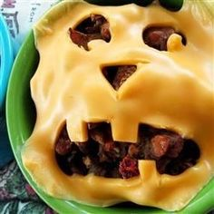 "Halloween Jack o Lantern Beef Pies | ""Yummy biscuit cups filled with spicy beef mixture and topped with Halloween pumpkin faces!"""