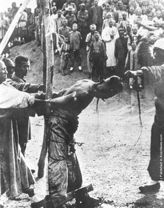 """1900 The public execution of a """"Boxer"""" leader in China at point-blank range during the Boxer Rebellion by Keystone/Getty Images"""