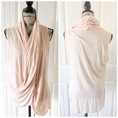 """Jennifer Lopez Pretty Light Pink Draped Top This top is light & stretchy with a figure loving draping in the front. This top is perfect for a date night w/ its soft feminine color and flattering draped style.{actual color of item may vary slightly from pics}  *shoulders:15.5"""" *chest:22.5"""" *waist:18"""" *length:27"""" *material/care:100% rayon machine wash  *fit:true/and stretchy but style might work for med too  *condition:good  20% off bundles of 3/more items No Trades  NO HOLDS No transactions…"""