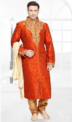Make a stunning entrance floating in this mens kurta, pajama set in brocade, shaded orange. The ethnic lace, resham and stones work over a apparel adds a sign of attractiveness statement for your look. Brocade might vary from actual image. #onlinebuykurtapajama #kurtapajamashervani #designerkurtas