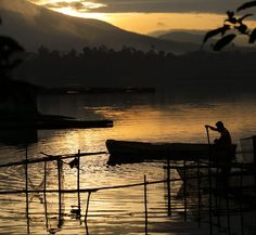 A fisherman is shown in Lake Sampaloc, one of the Seven Lakes in San Pablo, Laguna, which received the 'Threatened Lake of the Year 2014' tag from the Global Nature Fund. EPA