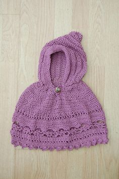 """Ravelry: Baby Poncho pattern Coats and Clark (free pdf) Skill Level: Intermediate  A fun, flirty border will have everyone cooing over this sweet baby poncho. A hood makes it practical and warm. Directions are for babies aged 12 months to 2 years.  supplies: TLC """"Wiggles"""", (3.5oz/250 yd ball): 2 Orchid.  Crochet Hook: G/6/4mm, Yarn needle; one 5/8"""" button; sewing needle and thread."""