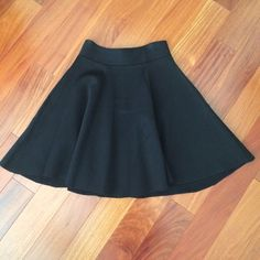 NWT EXPRESS Black Skirt Cute black skirt with stylish silver zipper. Fits high waisted. Never worn - tags attached. Express Skirts