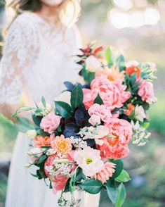 Ideas for Your Spring Wedding Bouquet | Martha Stewart Weddings - A few big peonies made all the difference in this long Plenty of Petals bouquet with roses and dahlias. #weddingbouquets #weddingflowers #weddingideas