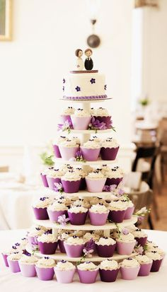I love this cup cake wedding cake idea. There wouldn't be anything to cut if you wanted to save the top tier for an anniversary but it would be so much easier to serve guests because no cutting is involved.  @Kassie Alderson Alderson Kissane