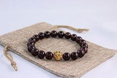 Morgan Bracelet 10 MM Ox Blood Red Agate Beads flanking a beautiful Gold Crystal ball.