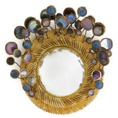 Objet : miroir Line Vautrin, design français, 1950s, femmes artistes, métal, verre
