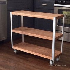 Chop a board into 3 shelves.  Screw metal angle to corners.  Add casters.  Easiest bookshelf ever.  More details #ontheblog today.  #plans #diy #anawhite #modern #industrial #starterproject