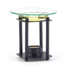 Four slender matte-black columns stylishly support a shallow glass oil dish; a tealight gently warms your favorite oil to disperse a subtle fragrance. Simple contemporary styling is a fabulous fit for any décor! Metal with glass dish. Modern-art Oil Burner by Rustica House. #myRustica