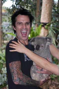 This would be Tommy Lee holding a koala bear. This is the cutest, badass thing I've ever seen.
