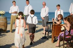 Cutest flower girl and ring bearer with flower crown at Corolla Beach Wedding    Heart of Harlow Outer Banks wedding coordinator Photogrpahy by Neil GT Photography