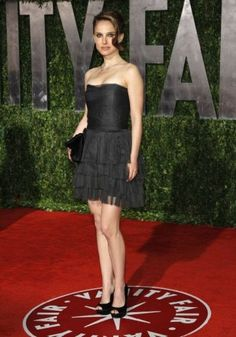 Natalie Portman's black evening dress with strapless neckline hits high above the knees.  Order this dress today for your next evening outing!