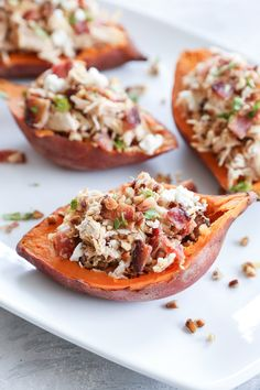 These loaded sweet potato skins are stuffed with shredded chicken, bacon, goat cheese and pecans for an added crunch. Always a crowd-pleaser, these are great served as a game day appetizer or at a gathering with friends and family. Sweet Potato Skins, Loaded Sweet Potato, Loaded Baked Potatoes, Mashed Sweet Potatoes, Stuffed Potatoes, Pecan Chicken, Chicken Bacon, Shredded Chicken, Healthy Superbowl Snacks