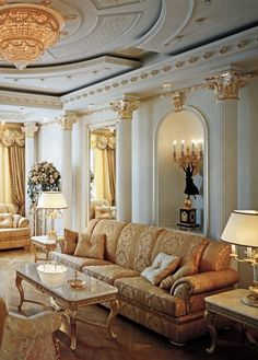 formal living room. white and gold. columns. decorative capitals.
