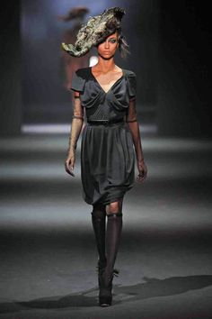 This was a romantic thread, with girls walking in thigh-high stockings (with hemlines high enough to show off said thighs). It all felt like this was coming straight from the boudoir with ruffled bodysuits. Only the cape-like coats and a handful of day dresses and pleated suits felt like they could be worn outside the boudoir. - HarpersBAZAAR.com