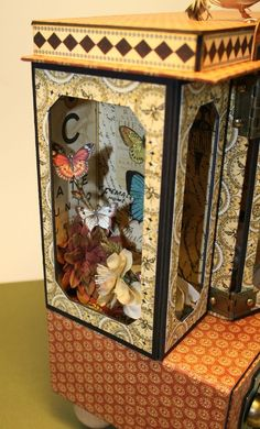 Astonishing altered curio cabinet and mini album by Laura Denison.