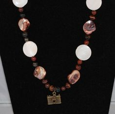 Check out this item in my Etsy shop https://www.etsy.com/listing/264234259/beaded-jewelry-set-brown-and-white-shell