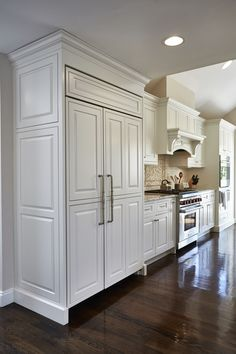 Built In Refrigerator With Custom White Cabinetry Panels #customcabinets  #refrigerator #whitecabinets #