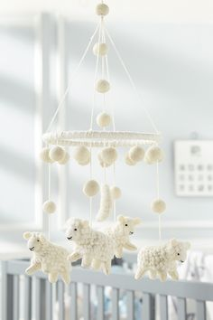 Hand-crafted mobile features boiled wool lamb and pom-pom accents on looped cotton cord for hanging. 24 x dia This item is being released as part of Mud Pie Lamb Nursery, Nursery Crib, Nursery Decor, Pumpkin Pillows, Wool Pillows, Mud Pie Gifts, Turkey Table, Unicorn Mobile, Pom Pom Mobile