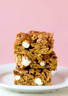 Golden Grahams S'mores Bars.. **Pin Tested by The Sugared Pepper** I made these this weekend, and while I'd make adjustments to our preferences ...her recipe was easy to follow and delicious!  A definite high five to The Brown Eyed Baker!