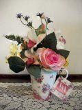 fun making flower arrangements in tea cups
