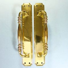 A magnificent pair of very large, very heavy door handles. Each handle has 4 countersunk holes for fixing screws, the handles are bolted to the backplates. Now sold