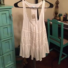 White Flowy Tank Top - NWT This tank has never been worn but would be super cute with jeans or shorts. American Eagle Outfitters Tops Tank Tops