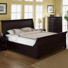 Oak wood sleigh bed.   Product: Queen bedConstruction Material: WoodColor: Dark brown...