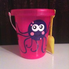 Party favor for birthday party. Dollar tree sand bucket and octopus made with adhesive vinyl.