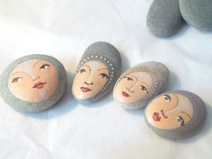 Painted stones. BUT it could  be painted on polymer clay.