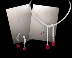 From left to right:  Classic earrings in 18-carat white gold, paved with brilliant- and princess-cut diamonds, set with drop-cut pink tourmalines. Classic necklace in 18-carat white gold, paved with brilliant- and princess-cut diamonds, set with two drop-cut pink tourmalines.