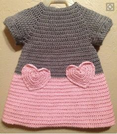 """I like the idea of crocheting a heart and making it into a pocket on a fabric shirt/skirt/dress. [ """"Soft & Beautiful Crocheted Pink and Grey Baby Toddler Dress Heart Pockets…"""", """"Color idea only."""", """"Lily by Michael Sodeau for Modus"""" ] # # # # # # # # # Baby Girl Crochet, Crochet Baby Clothes, Crochet For Kids, Knit Crochet, Crochet Children, Baby Patterns, Crochet Patterns, Baby Sweaters, Pullover Sweaters"""
