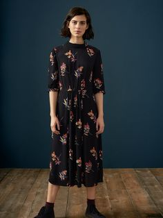MAIE PRINT DRESS   Fluid viscose crepe in a floral print. Stand collar with keyhole opening at back. Elbow-length sleeves with turned-up cuffs. Panelled skirt. Lightly gathered at waist. Concealed side zip. Pockets.