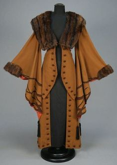 WOOL COAT with APPLIQUE and FUR TRIM, EARLY C. Light brown with exaggerated wizard sleeve appliqued in darker brown with black silk tassels, fur collar and cuff, contrasting faux button trim and satin lining. Perhaps not for everyday Retro Mode, Mode Vintage, Vintage Coat, Looks Vintage, Historical Costume, Historical Clothing, Edwardian Fashion, Vintage Fashion, Edwardian Era