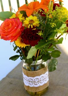 Mason jar vases from lace and burlap