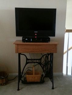 A tv stand from a old singer sewing machine.