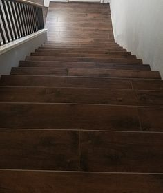 Custom stairs with plank wood look tile