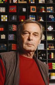 ERNŐ RUBIK - a Hungarian inventor, architect and professor of architecture. He is best known for the invention of mechanical puzzles including Rubik's Cube, Rubik's Magic, Rubik's Magic: Master Edition, Rubik's Snake and Rubik's Profession Of Faith, Heart Of Europe, Celebrity Gallery, Tomorrow Will Be Better, Budapest Hungary, My Heritage, Professor, Techno, America