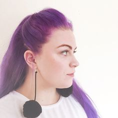 It's hard to do a serious face when you have such fabulous earrings on. DIY Pom Pom earrings on theseglitteryhands.com right now!  #pompom #pompomearrings #craftblogger #purplehair #diypompom #crafty #craftlife #craftsposure #craftaholic #pompoms #pompomgirl #cute #purplehairdontcare