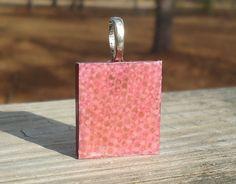 Pink Snake Skin Pattern Scrabble (c) Tile Pendant. $7.50, via Etsy.
