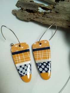 Stunning Polymer clay and resin earrings. Love the graphic pattern combinations of yellow, black and white polymer clay.