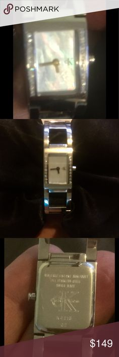 Diamond bezel Swiss watch w- mother of pearl face #RARE! You can't find ! I tried so I can price it! THIS MODEL serial #K4213.02  40M Calvin Klein (is rare)Women's Diamond watch Swiss Made with Mother of Pearl face! Used twice . I paid 500€ for it) I have found some references & posted pics of exact watch w/ black face not mother of pearl! 20 diamonds all clean about vs quality! Serious buyers! No low baling Calvin Klein Collection Accessories Watches