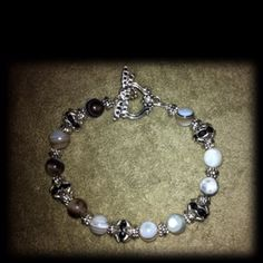 Sterling silver plate, Tibetan silver, Swarovski crystal, real stones bracelet. $12.00 and I ship also for a small fee  diana.wickline@facebook.com Also visit my Facebook page and browse my handcrafted jewelry I sell Abby's Heavenly Designs.