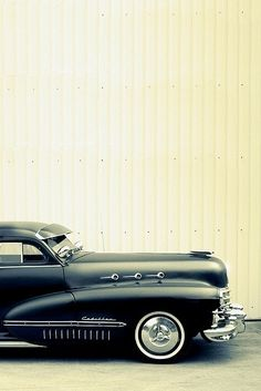 Cadillac, Cadillac.  Long and dark, shiny and black.  Open up your engines, let `em roar.  Tearing up the highway like a big old dinosaur (Bruce Springsteen)