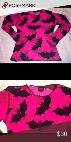 Vintage Velvet BATS Cyber goth Hot Pink Mesh shirt Vintage OMEN Clothing U.K. Hot screaming pink mesh stretchy sheer top with black velvet flocked BATS print! Worn a few times. Great used condition.  Very stretchy, but measurements are: 16.5 chest across, 22 in rear length, 19 in front length, 14 waist, 16 across hemline, 17 in shoulder seam to seam, 22 in shoulder seam to end of sleeve.  Incredible quality and detail, with omen tag on waist, exterior stitch and the cutest ever fuzzy bats…