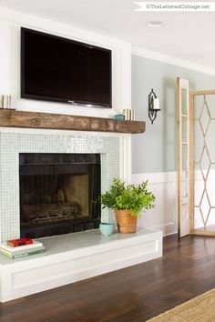 This is similar to what I want to do to my fireplace surround.They built around the existing brick hearth. Unless I want to bust up rock that& what I& need to do. I also want to find a beam to use! found via HGTV Room Fireplace Redo, Faux Fireplace, Fireplace Remodel, Fireplace Surrounds, Fireplace Design, Glass Tile Fireplace, Fireplaces, Fireplace Makeovers, My Living Room